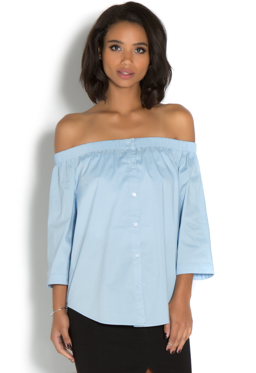 A pretty off-the-shoulder top (you'll be seeing a lot of these this season), featuring an easy elastic neckline. Body length: Cotton. Machine wash. Import.