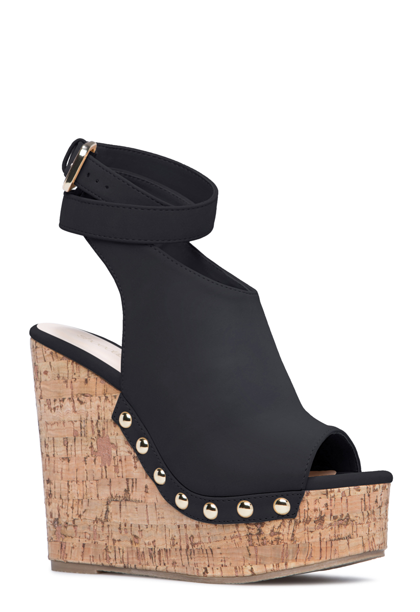 ebf8ea22d6be Material  Faux-suede. Imported. Color  BLACK  Outside Wedge Height  5