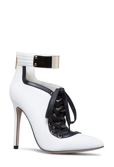 6a0c0785cd6 Material  Faux-Leather  Fit  True to Size  Color  White Black  Outside Heel  Height  4.25